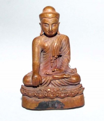 Pra Kring Tan Jai represents the Wishfulling Buddha seated in the 'subduing Mara' posture; this authentic Buddhist loi ongk statuette is made by the revered Lanna master Kroo Ba Buddha.