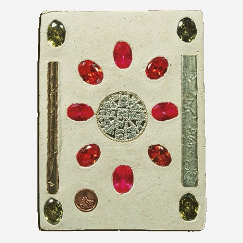 12 precious gemstones, and 2 solid Silver Yantra Foil Takrut Magic spells are inserted into the rear face of the amulet