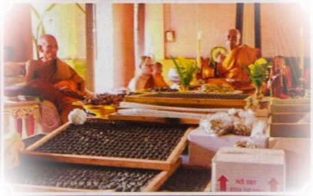 Buddhist guru monks of the Luang Por Tuad lineage, performing blessings of amulets