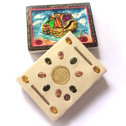 Sacred precious gems are inserted into the rear face of the finely crafted sacred powder amulet